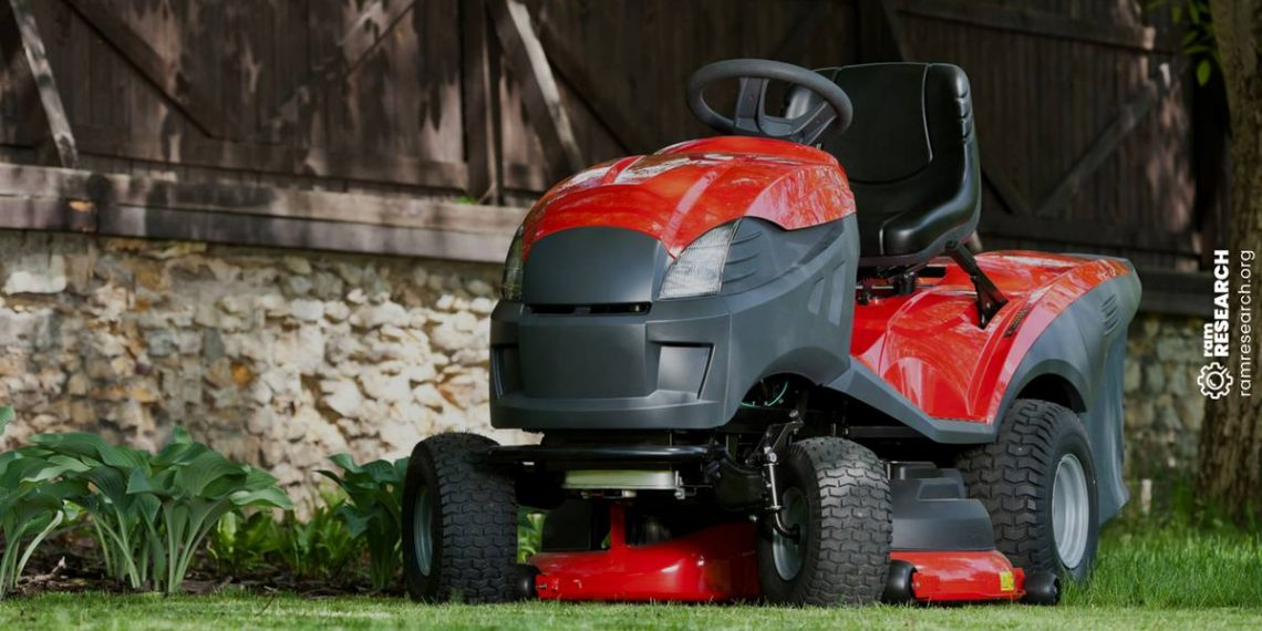 red riding lawn mower next to a house