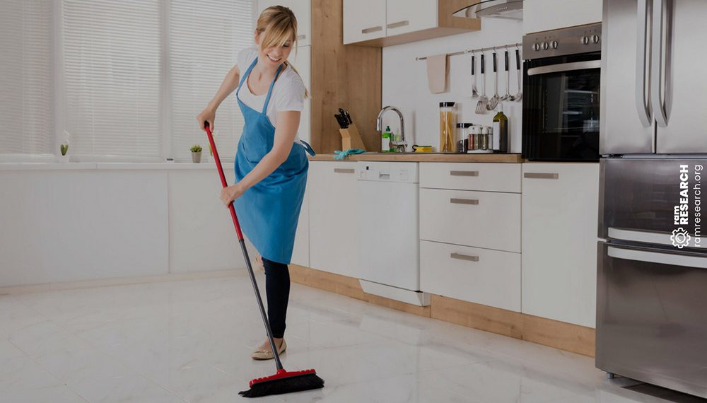 lady sweeping tiled kitchen