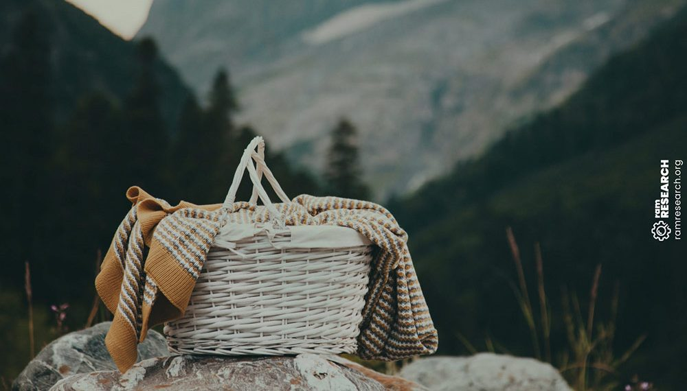 picnic basket on a rock in the mountains