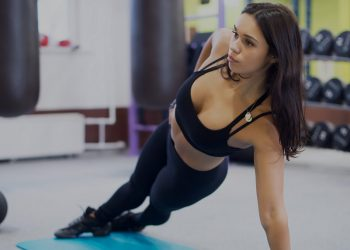 lady in side plank wearing tights and a bra