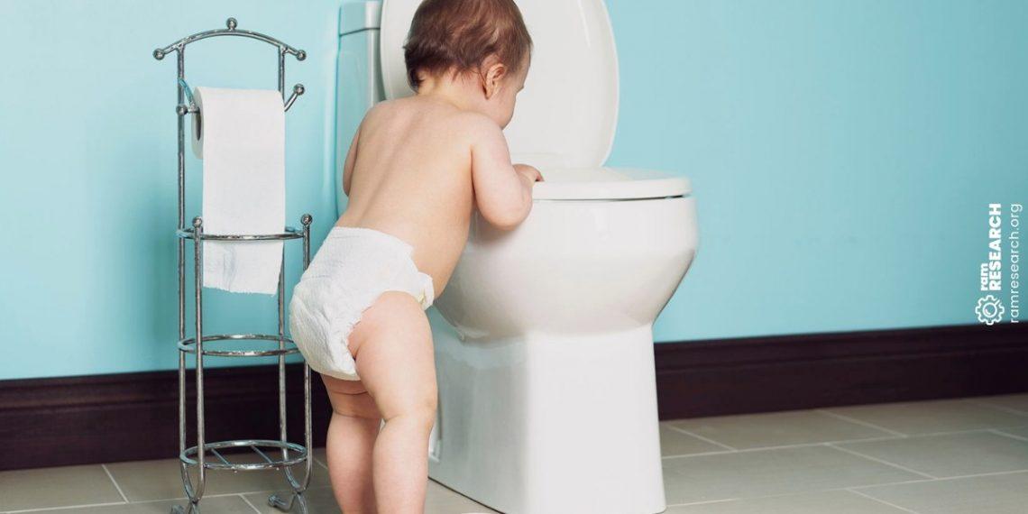 Kid next to a toilet