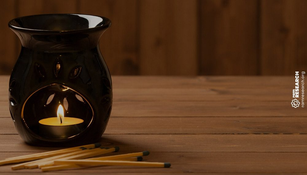 black oil burner with candle burning inside