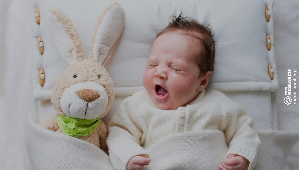 Baby sleeping next to a bunny rabbit