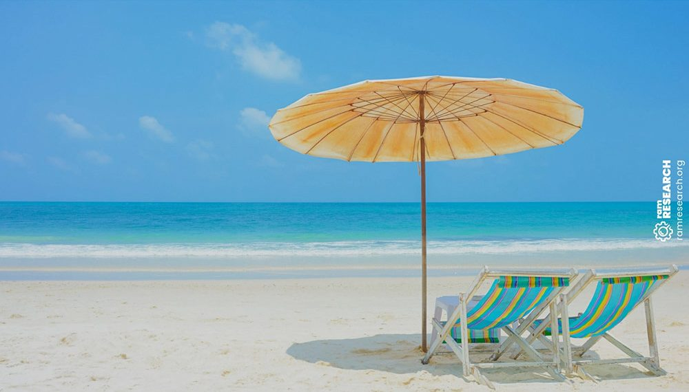 two beach chairs under and umbrella