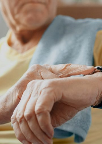 elderly person checking the time