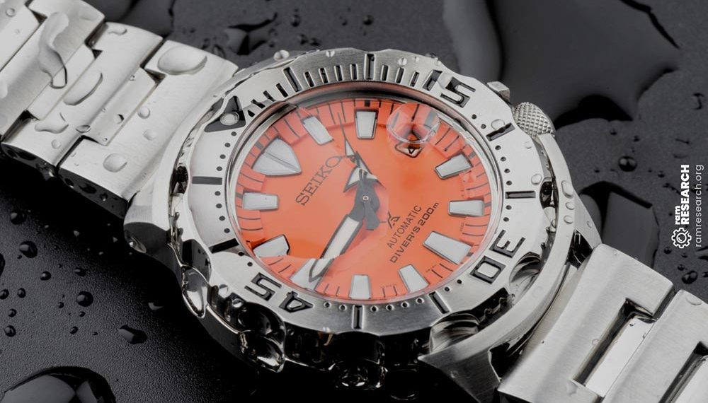seiko orange face watch with water on it