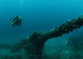 shipwreck and a diver