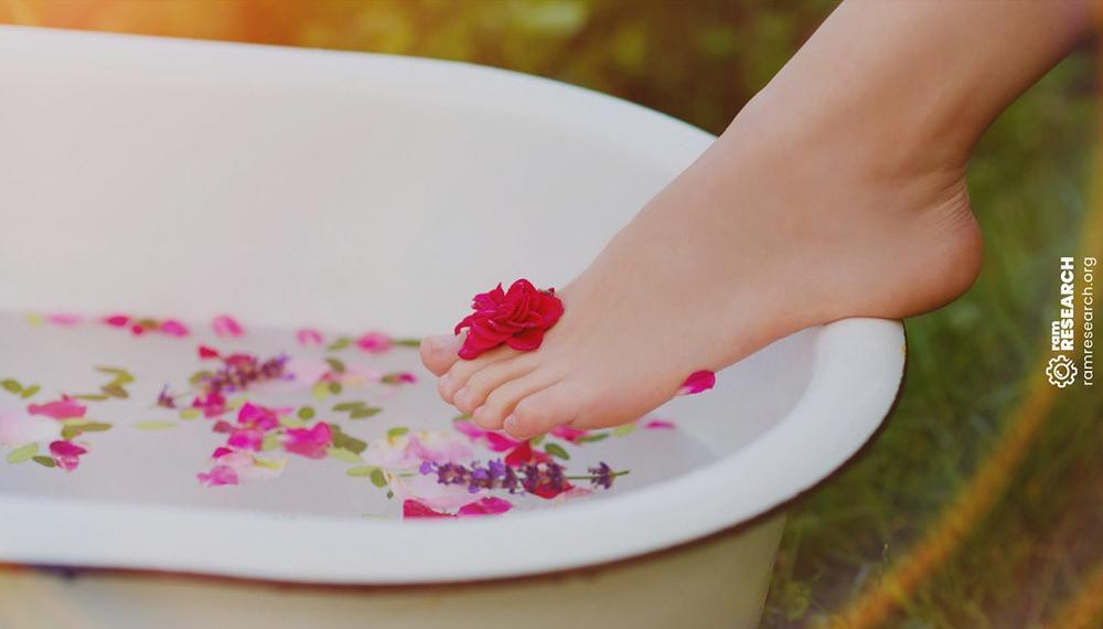 womans foot stepping into a foot spa