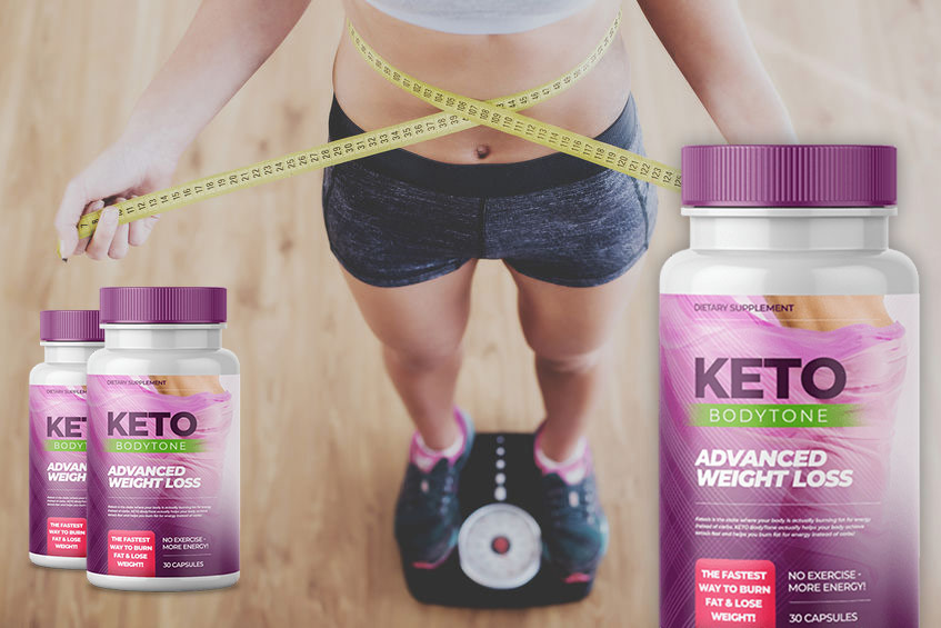 woman measuring her waist standing in a scale next to keto bodytone bottles