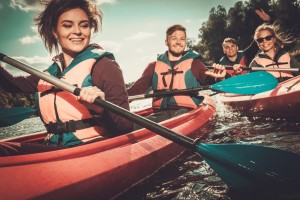 Group of happy people on a kayaks