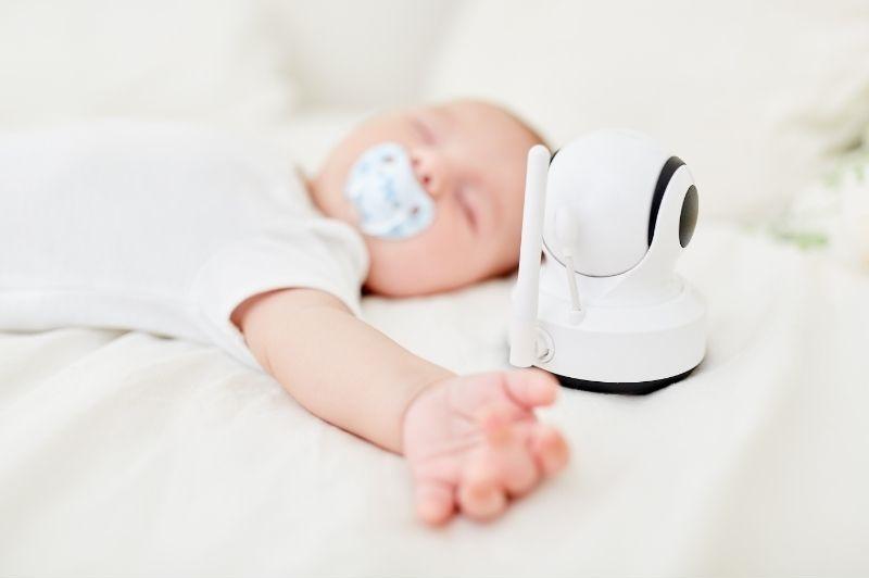 Baby monitor monitoring a baby