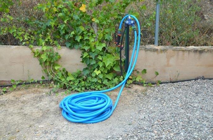 garden hose near the spigot